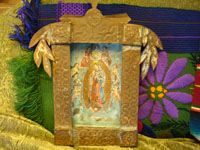Mexican vintage tinwork, tin nicho with oil painting of Our Lady of Guadalupe, 1930's.