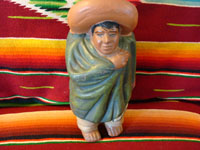 Mexican vintage pottery, bank in form of Mexican rancher, c. 1920.