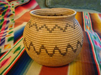 Native American basket, Chemehuevi olla with 2 bands of geometric zig zag lines, c. 1920.