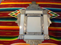 Another photo of Mexican tinwork mirror.