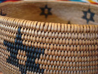 Native American Indian basket, Washo basket with stars, closeup photo.