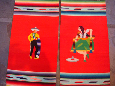 Mexican vintage textiles and Saltillo sarapes, a wonderful pair of matching Saltillo sarapes featuring a dashing Mexican charro (horseman) and a lovely China Poblana or charra dancing around a sombrero, c. 1940's. They are both finely woven of soft wool, and the colors are vibrant. Closeup of the pair.