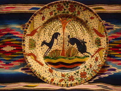 Mexican vintage pottery and ceramics, a magnificent Tlaquepaque plate with a starry-night background and decorated with leaping animals and birds, Tlaquepaque, Jalisco, c. 1920-30's. Attributed to the famous artist, Balbino Lucano or his brother Tomas Lucano.