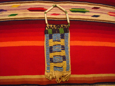 Native American Indian antique beadwork and folk-art, a Lakota (Sioux) beaded ration-pouch, c. 1890-1900.