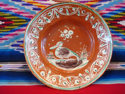 Mexican vintage pottery and ceramics, a bandera-ware plate with a graceful pelican and wonderfully intricate border, Tonala or Tlaquepaque, Jalisco c. 1930's.