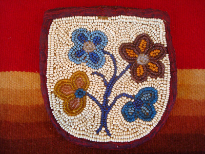 Native American Indian beadwork, a beautiful beaded pouch on native-tanned hide, Woodlands Indian, c. 1910-20.