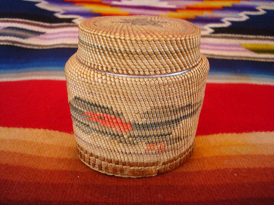 Native American Indian antique basket, a finely woven Northwest Coast basket, woven around a Pond's Cold Cream Jar and lid, Nootka or Makah Indians, c. 1920's.