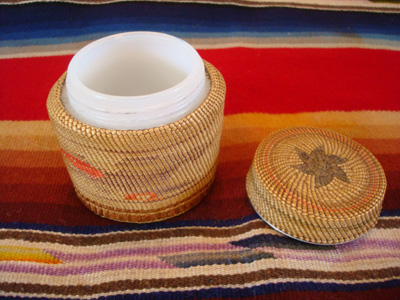 Native American Indian antique basket, a finely woven Northwest Coast basket, woven around a Pond's Cold Cream Jar and lid, Nootka or Makah Indians, c. 1920's. The weaving features wonderful eagles on two sides of the jar.