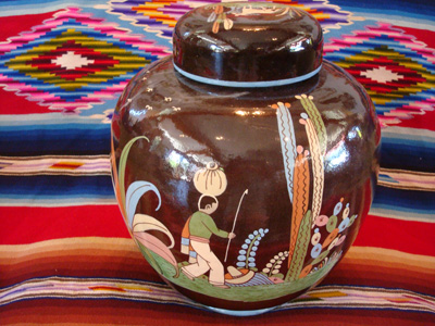 Mexican vintage pottery and ceramics, a large lidded black-ware tibor, Tlaquepaque, Jalisco, c. 1920's. The artwork of this piece is incredibly wonderful; this is a museum-quality piece of vintage Mexican pottery and a collector's dream!
