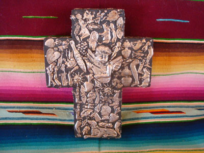 Mexican vintage devotional art, and Mexican vintage folk art, a beautiful wooden cross filled on three sides with silver milagros, c. 1950's.
