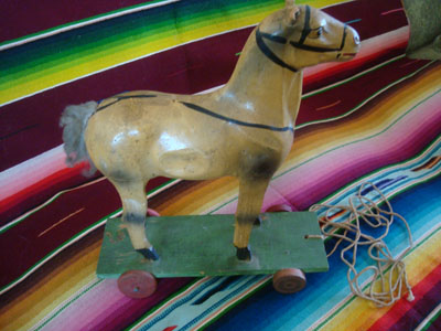 Mexican vintage folk art, a wonderful  paper mache horse on wheels and pulled with a string, c. 1940's.