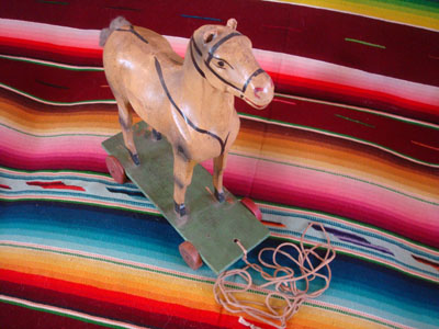 Mexican vintage folk art, a wonderful  paper mache horse on wheels and pulled with a string, c. 1940's. This is a great piece of vintage Mexican folk art! A frontal view of the horse.