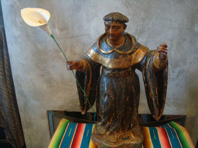 Mexican colonial devotional art, and Mexican colonial woodcarvings, a wooden statue of a saint, most likely St. Dominic, Mexico, c. 17th century.