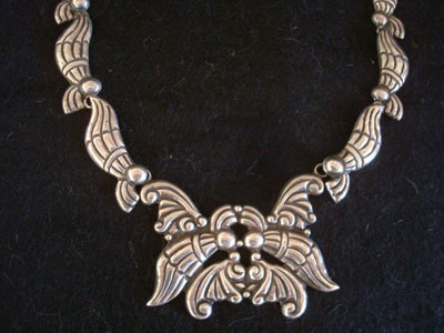Mexican vintage sterling silver jewelry, and Taxco vintage silver jewelry, a wonderful sterling silver necklace with very fine repousee silverwork, Taxco, c. 1940's. The very elegant design and fine silverwork make this necklace very special and beautiful! Closeup photo of the main part of the Taxco silver necklace.